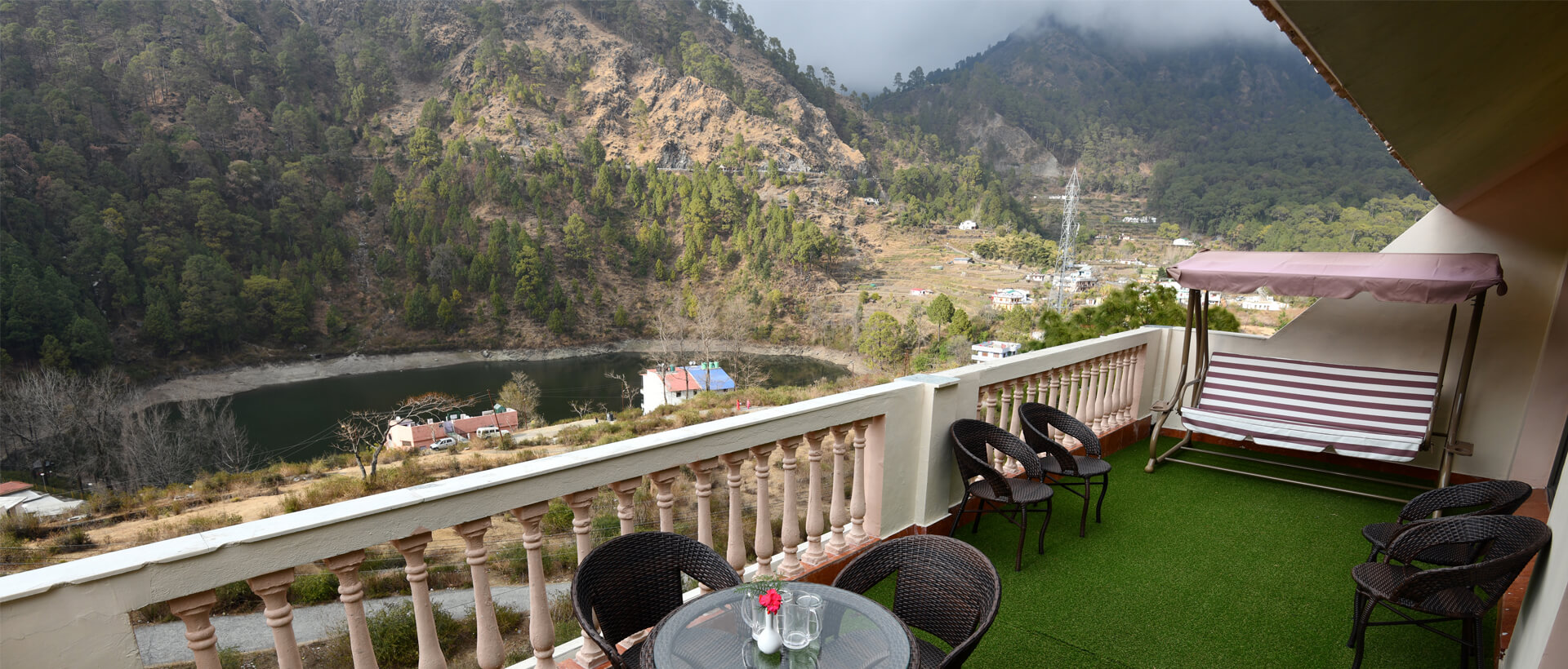 enjoy Moutains and greenery of nainital from dynasty hotel sitting area